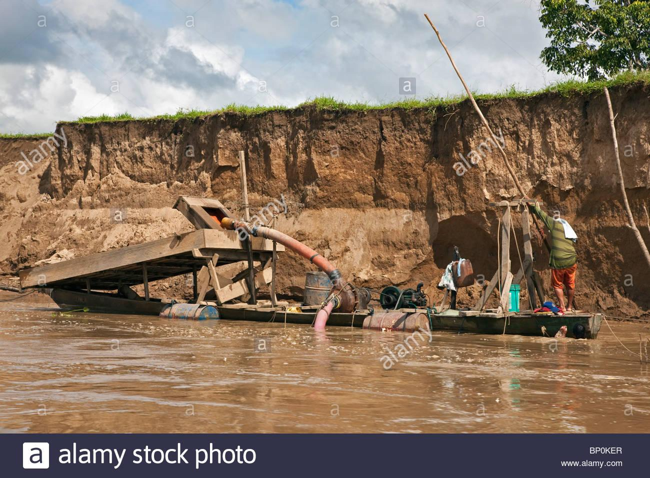peru-a-floating-dredge-on-the-madre-de-dios-river-which-is-used-for-BP0KER.jpg